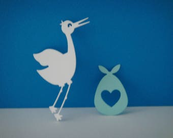 Cut out door and white stork baby light blue