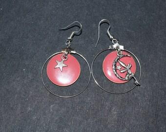 Asymmetrical pink enamel and silver metal hoop