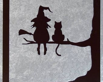 The Witch and her cat - table silhouette in woodcut
