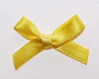 25 x 7mm Satin ribbon bow: yellow - 02343