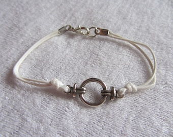 thin spacer ring bracelet, sailor knot in silver and white knotted waxed cotton cord
