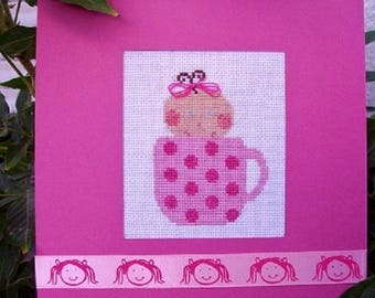 Hand embroidered card: head of chubby baby in pink Cup