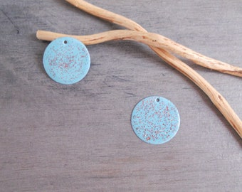 2 sequins light turquoise and glittery copper (one side pattern and a solid)