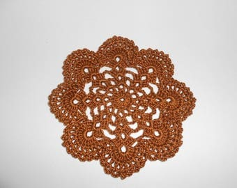 chocolate-colored crocheted doily