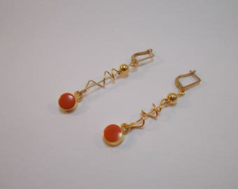 dangling earrings in gold and coral