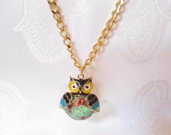 Here is a long necklace with a gold OWL and her floral belly!