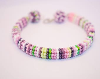 Delicate melange bracelet from beads.