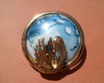 porcelain with embossed blue Swan brooch