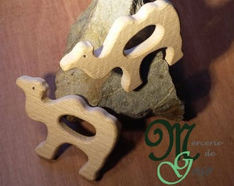 Natural wooden teething ring. Chamaeu shape.
