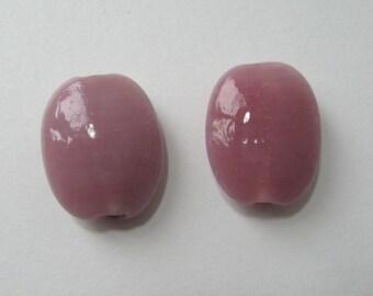 Set of 2 flat beads, glass, 23 x 19 mm, pink.