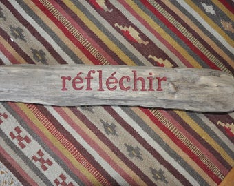 Think: engraving on Driftwood picked up on the beach of L'espiguette