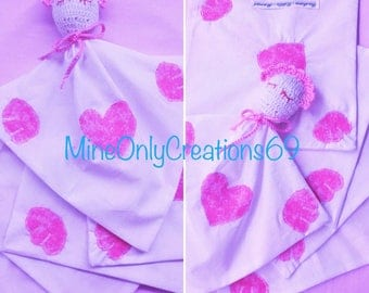 In pink and white fabric rag blanket