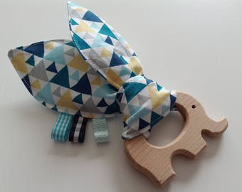 Untreated wood elephant teether and geometric pattern fabric