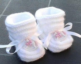 Pair of white baby booties