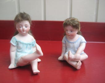 2 Antique porcelain bisque baby dolls with real hair. ca. 1900