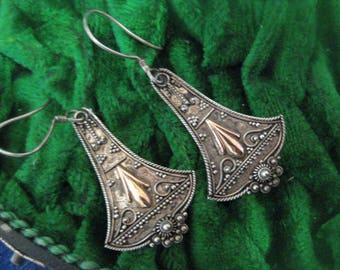 Silver earrings handicraft with gold laying piece