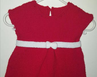Red dress with white belt and white bow and headband