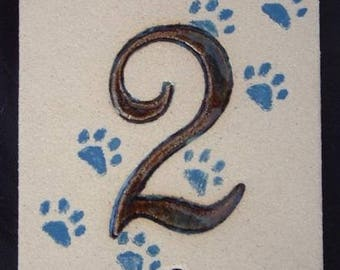 Door number '2' cat paws prints