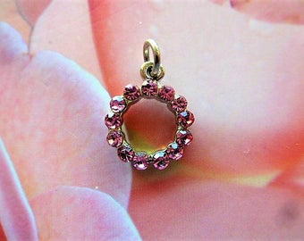 Pink rhinestones mounted on silver plated circle charm