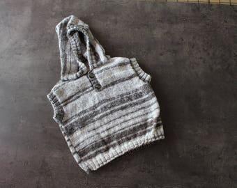grey sleeveless hooded sweater
