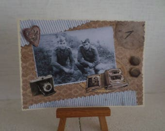 vintage with two men, a camera, photo album