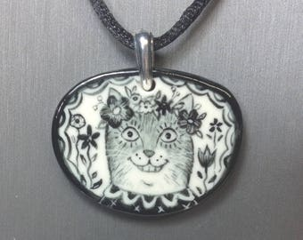 "Happy Cat Pendant/Necklace. Hand painted porcelain with 16"" black cord. Signed"