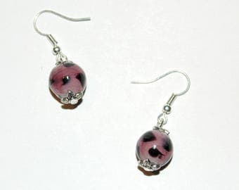 Purple earrings with polka dots