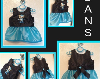 Dress in satin fabric turquoise blue and black. Matching embroidery pattern.
