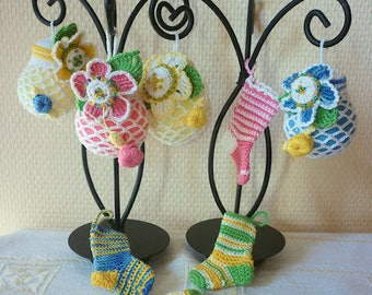 Christmas decoration: bulbs colorful and tiny crocheted socks