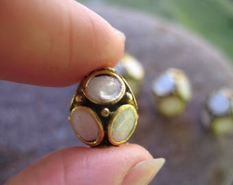 1 golden white Indonesian bead and polymer clay