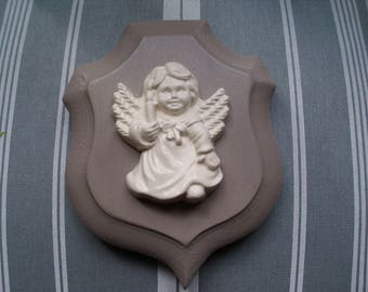 Angel plaster on wooden plaque