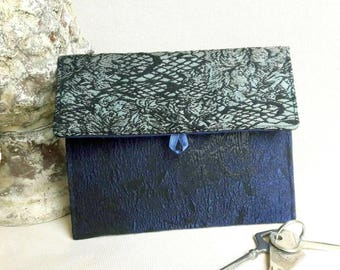 Navy Blue multi-use pouch, black and green.
