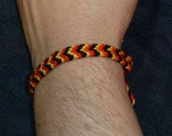 Lens in red, yellow and black herringbone bracelet
