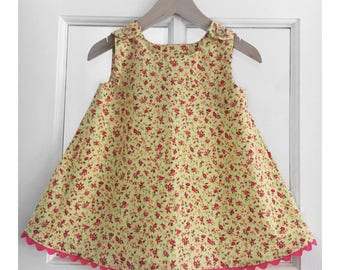 Yellow and pink floral little girls 2 piece dress and knickers, size 12-18M.