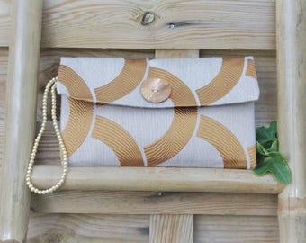Party clutch bag in a beige and golden fabric