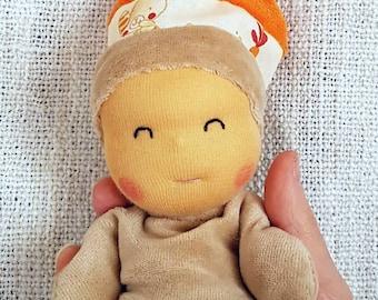 Plush doll tipoupidou beige and Orange