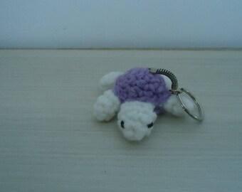 White and purple turtle keychain