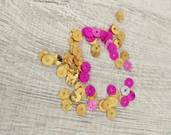 Yellow and pink sequins beads