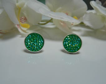 Made with a green glittery cabochon Stud Earrings
