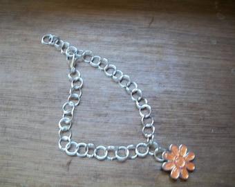 Orange rings and flower bracelet