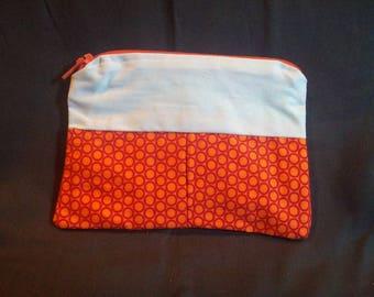 White and orange pattern wallet red circles