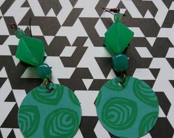 Contemporary style earrings with paper disks, glass beads and acrylic items