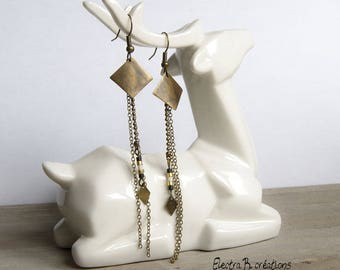 Long and thin ivory black Rhombus bronze earrings