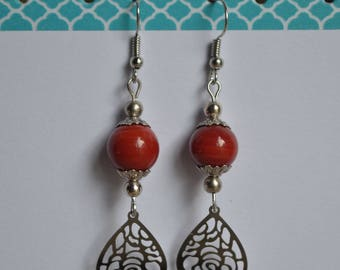 Earrings with red bead and drop print
