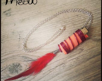 Lighter ethnic pink with a red feather