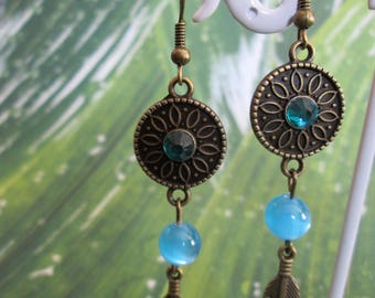 rose and bronze and blue feather earrings