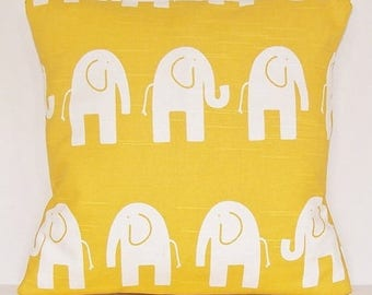pillows with White Elephants on yellow background