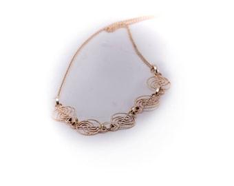 Yellow gold vintagecircular link necklace, circa 1970