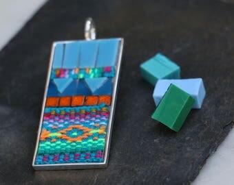 Pendant glass mosaic, fabrics and baked land of the Peru