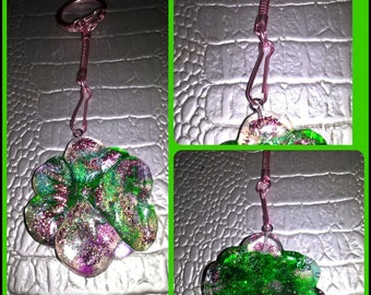 Key shaped translucent resin tinted with green and purple flower